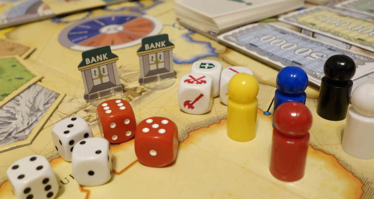 Games and dices, playcards, figurines and symbols. Casual leisure gaming.