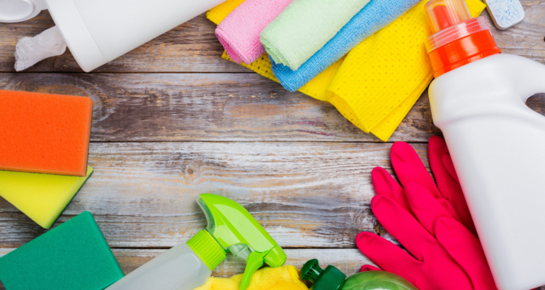 Spring cleaning of house. Cleaning supplies set on wooden background. Copy space